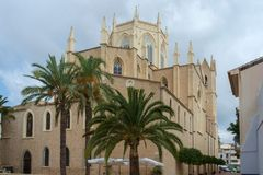 Benissa Church, Benissa, Costa Blanca, Spain. The Benissa Church dates from the early 20th century. This view shows some of the many palms which surround the Royalty Free Stock Photos