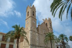 Benissa Church, Benissa, Costa Blanca, Spain. Palm trees surround Benissa church in the centre of town Royalty Free Stock Images