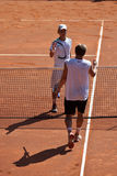 Benjamin Balleret and Renzo Olivo handshake. Benjamin Balleret (MON) and Renzo Olivo (ARG) handshake at ATP Genoa Open Challenger 2011 (Italy Stock Photos