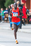 Benjamin Chebet from Kenya later came in as number six in ASICS Royalty Free Stock Images