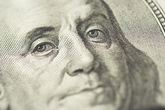 Benjamin Franklin. Close-up of Benjamin Franklin, one hundred dollars note. Shallow dof, focus on eyes Stock Photography