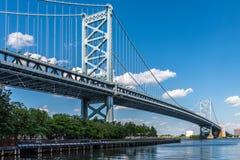 Benjamin Franklin Bridge Crossing the Delaware. The Benjamin Franklin Bridge spans the Delaware River from Philadelphia to Camden, New Jersey stock photo