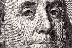 Benjamin Franklin, a close-up portrait. On US hundred dollars stock photo