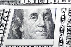 Benjamin Franklin en los cientos billetes de dólar enmarcados por otro Imágenes de archivo libres de regalías