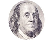 Benjamin Franklin face in ellipse on 100 dollar bill o white background. Photo, macro royalty free stock photography