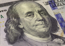 Benjamin Franklin face on US hundred or 100 dollars bill macro, united states money closeup. Stock Photography