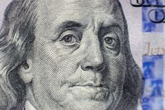 Benjamin Franklin face on us one hundred dollar bill macro isolated, united states money closeup.  stock images