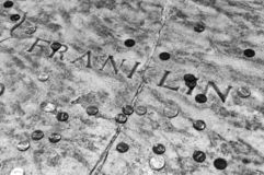 Benjamin Franklin grave covered in coins at Christ Church Burial Ground in Philadelphia, PA, USA.  stock photos