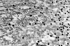Benjamin Franklin grave covered in coins at Christ Church Burial Ground in Philadelphia, PA, USA.  stock photo