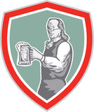 Benjamin Franklin Holding Beer Shield Retro. Illustration of Benjamin Franklin holding mug of beer looking to the side set inside shield crest on isolated stock illustration