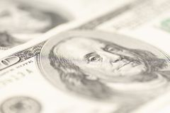 Benjamin Franklin on hundred dollars banknote. Selective focus royalty free stock photo