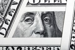 Benjamin Franklin on the one hundred dollar bill framed by one dollar banknotes. Benjamin Franklin on the one hundred dollar bill framed by one dollar banknotes royalty free stock photos
