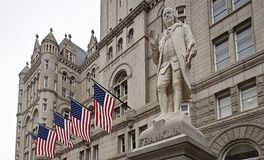 Benjamin Franklin one of our founding fathers greets passer byers as they walk pass Trumps International Hotel. Royalty Free Stock Photos