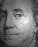 Benjamin Franklin portrait from a $100 bill. Macro shot of Benjamin Franklin portrait from a $100 bill isolated royalty free stock images
