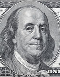 Benjamin Franklin portrait on one hundred dollar bill closeup. US President Benjamin Franklin portrait on one hundred dollar bill fragment macro Stock Photography