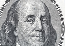 Benjamin Franklin portrait on one hundred dollar bill closeup. US President Benjamin Franklin portrait on one hundred dollar bill fragment macro royalty free stock photo