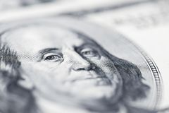 Benjamin Franklin`s eyes from a hundred-dollar bill. The face of Benjamin Franklin on the hundred dollar banknote, backgrounds,. Close-up. 100 dollar bill with royalty free stock photography