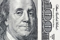 Benjamin Franklin`s eyes from a hundred-dollar bill. The face of Benjamin Franklin on the hundred dollar banknote, backgrounds,. Close-up. 100 dollar bill with stock photo