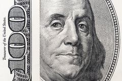 Benjamin Franklin`s eyes from a hundred-dollar bill. The face of Benjamin Franklin on the hundred dollar banknote, backgrounds,. Close-up. 100 dollar bill with royalty free stock image