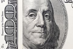 Benjamin Franklin`s eyes from a hundred-dollar bill. The face of Benjamin Franklin on the hundred dollar banknote, backgrounds,. Close-up. 100 dollar bill with royalty free stock photo