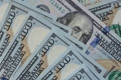 Benjamin Franklin`s eyes on one hundred dollars banknote close-up. royalty free stock photos