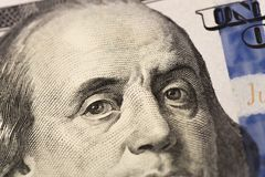 Benjamin Franklin`s look on a hundred dollar bill. Benjamin Franklin portrait macro usa dollar banknote or bill.  stock image