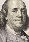 Benjamin Franklin`s look on a hundred dollar bill. Benjamin Franklin portrait macro usa dollar banknote or bill.  royalty free stock photo