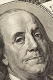 Benjamin Franklin`s look on a hundred dollar bill. Benjamin Franklin portrait macro usa dollar banknote or bill.  stock photo