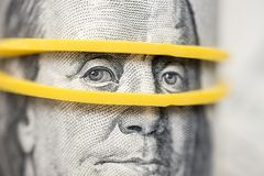 Benjamin Franklin`s look on a hundred dollar bill highlighted with gum.  royalty free stock images