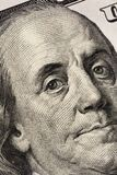 Benjamin Franklin`s look on a hundred dollar bill. Benjamin Franklin portrait macro usa dollar banknote or bill.  royalty free stock image