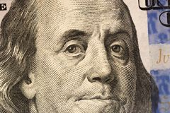 Benjamin Franklin`s look on a hundred dollar bill. Benjamin Franklin portrait macro usa dollar banknote or bill.  royalty free stock images