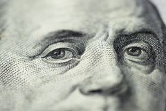 Benjamin Franklin`s look on a hundred dollar bill. Benjamin Franklin portrait macro usa dollar banknote or bill. Selective focus stock photography