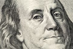 Benjamin Franklin`s portrait on one hundred 100 american dollar bill. Macro close up view stock photo