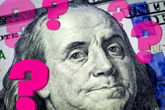 Benjamin Franklin's portrait and question marks. Expressing financial uncertainty - Financial concept stock illustration