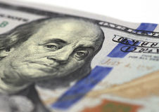 Benjamin Franklin stare. Close up of Benjamin Franklin stare on one hundred dollars banknote stock image