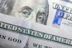 Benjamin Franklin stawia czoło na my sto dolarowych rachunków makro- obrazy stock