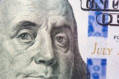 Benjamin Franklin on us one hundred dollar bill macro stock photo