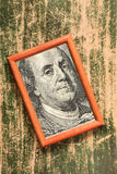 Benjamin Franklin 100 USA dollar portrait. In a wooden photo frame stock image