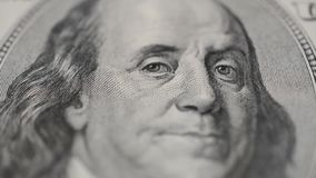 Benjamine Franklin portrait on one hundred dollar bill stock footage