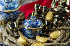 Benjarong Gold ingot  Red ribbon bow Gold  Chinese  Gift sets Stock Photography
