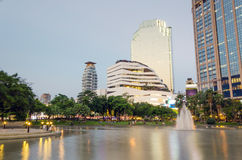 Benjasiri Park with many modern condominiums and business buildi Stock Images