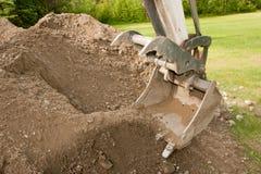 Benna dell'escavatore con la branca Fotografie Stock