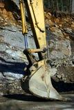 Benna di riposo dell'escavatore Immagine Stock