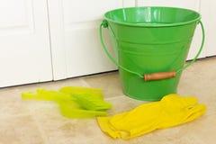 Benna verde e guanti gialli Fotografia Stock