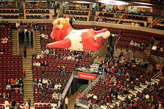 Benny the Bull Over United Center. An inflatable balloon of Benny the Bull, commonly known as Benny, the official  mascot of the Chicago Bulls of the National Royalty Free Stock Image