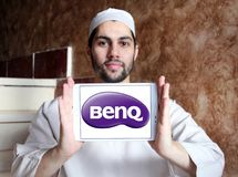 BenQ Corporation logo. Logo of BenQ Corporation on samsung tablet holded by arab muslim man. BenQ is a Taiwanese multi-national company that sells and markets Stock Images