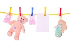 Bens do bebê que penduram no clothesline Fotografia de Stock