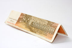 Bent banknotes of 5 billion dinars Stock Photos