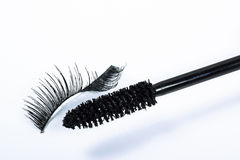 Bent false eyelash and a mascara brush Stock Photography