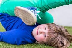 Bent girl lying on her back Stock Photography